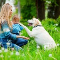 mother and son with labrador