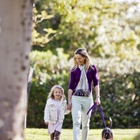 dog-owners-walking-their-dog-in-the-park